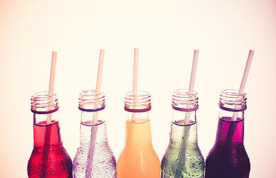 Colored Soft Drinks in Glass Bottles with Straws