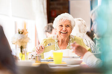 Senior Citizen Eating a Meal