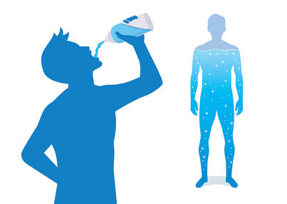 Silhouetted man drinking water